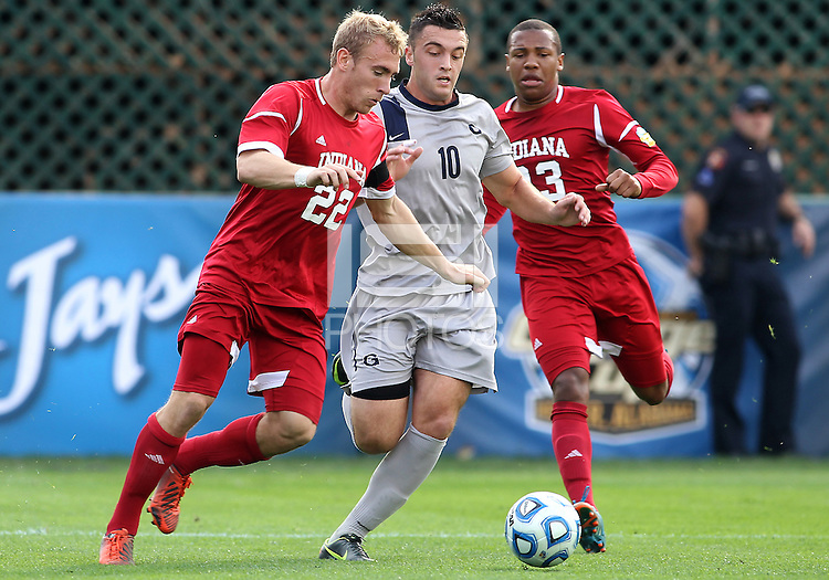 HOOVER, AL - DECEMBER 09, 2012: Caleb Konstanski (22) of Indiana University goes for the ball with Brandon Allen (10) of Georgetown University during the NCAA 2012 Men's College Cup championship, at Regions Park, in Hoover , AL, on Sunday, December 09, 2012.