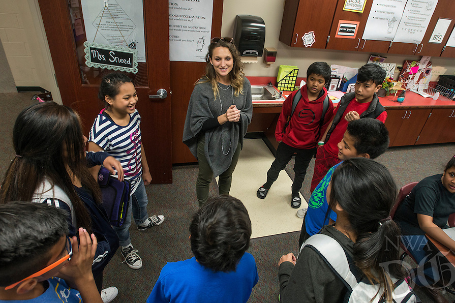NWA Democrat-Gazette/ANTHONY REYES @NWATONYR<br /> Natalie Sneed, ELA teacher at Hellstern Middle School, gives instructions to students Monday, Feb. 27, 2017 during an after school study session at the school in Springdale. On this day, they were getting started on their homework list for the week.