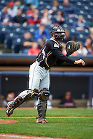 New Britain Rock Cats catcher Tom Murphy (9) throws to first for the out during a game against the Akron RubberDucks on May 21, 2015 at Canal Park in Akron, Ohio.  Akron defeated New Britain 4-2.  (Mike Janes/Four Seam Images)