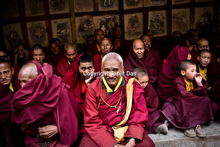 """Busshist monks gather to witness dancers perform at the Hemis Monastery (gompa) of the Drukpa Lineage, located in Hemis, 45 kms away from Leh in Ladakh. ..His Holiness the Twelfth Gyalwang Drukpa, the head of the Drukpa Lineage (proponents of the Mahayana Buddhist tradition) ended his """"Walking On The World's Rooftop"""" Pad Yatra from Manali to Hemis Monestary in Ladakh."""