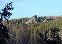 Rocky outcrop and forest in the mountains at Blewett Pass, WA in the Wenatchee Mountains. Stock photography by Olympic Photo Group