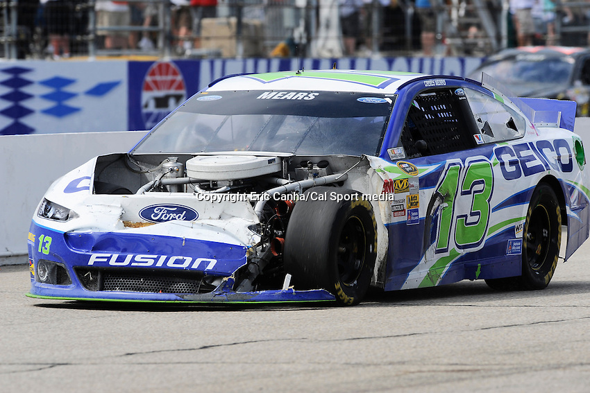 July 14, 2013 - Loudon, New Hampshire U.S. - Sprint Cup Series driver Casey Mears (13) drives a battered car to the pits during the NASCAR Sprint Cup Series Camping World RV Sales 301 held at the New Hampshire Motor Speedway in Loudon, New Hampshire.   Eric Canha/CSM