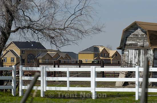 Barn, homes under construction, horses. Davis County project. 04/06/2005<br />