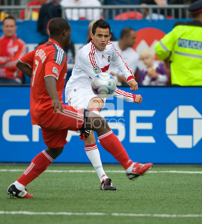 16 May 09: Chicago Fire midfielder Marco Pappa #16 attempts to clear a ball from Toronto FC defender Nana Attakora-Gyan #3  during action at BMO Field in a game between the Chicago Fire and Toronto FC..Chicago Fire won 2-0..