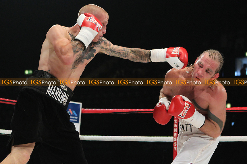 Lee Markham (black shorts) makes his pro debut beating Matt Scriven on points, promoted by Hennessy Sports - 23/07/11 - MANDATORY CREDIT: Chris Royle/TGSPHOTO - Self billing applies where appropriate - 0845 094 6026 - contact@tgsphoto.co.uk - NO UNPAID USE..