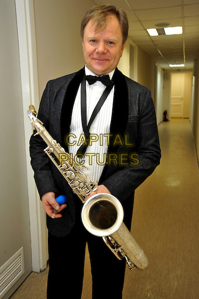 "Igor Butman.Concert in the Hall ""October"", St. Petersburg, Russia..February 1st, 2012.half length black tuxedo saxophone 3/4.CAP/PER/VB.©VB/PersonaStars/Capital Pictures."