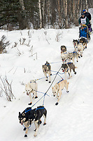 Louis Nelson Sr. w/Iditarider on Trail 2005 Iditarod Ceremonial Start near Campbell Airstrip Alaska SC