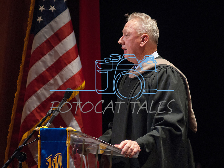 Chester Burton, Interim President does introductions and recognitions at the Western Nevada College commencement in Fallon, Nev., on Tuesday, May 20, 2014. <br /> Photo by Kim Lamb