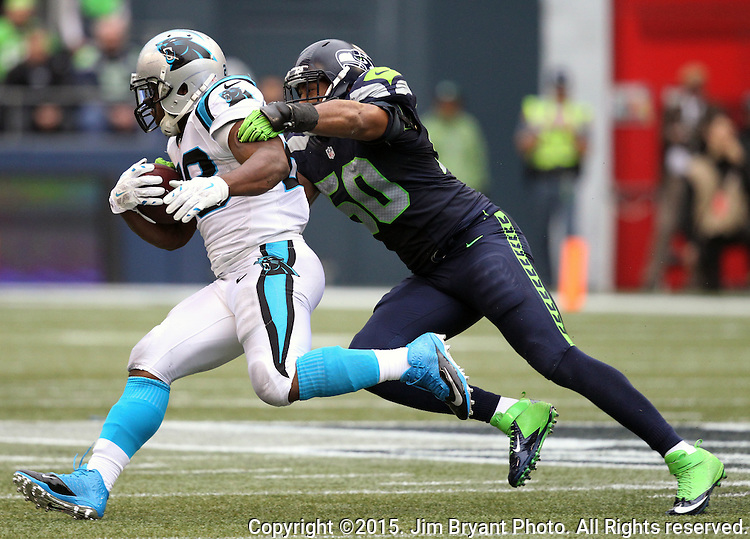 Seattle Seahawks linebacker K.J. Wright cuts off  Carolina Panthers running back Jonathan Stewart (28) at CenturyLink Field in Seattle on October 18, 2015. The Panthers came from behind with 32 seconds remaining in the 4th Quarter to beat the Seahawks 27-23.  ©2015 Jim Bryant Photography. All Rights Reserved.