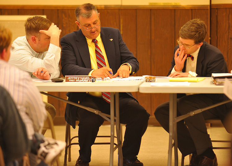 BETHLEHEM, CT-29 APRIL 2010-042910IP03- Jeffrey Hamel, First Selectman of Bethlehem and Michael Lynch (right), an attorney, look over paperwork during a meeting on a proposed land use ordinance at Memorial Hall in Bethlehem on Thursday.                                                                                                                                                                                                                                                                                                                                                                                                                                                                                                                                                                                                                                                                                                                                                                                                                                                                                                                                                                                                                                                                                                                                                                                                                                                                                                                                                                                                                                                                                                                                                                 <br /> Irena Pastorello Republican-American