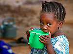 Two-year old Ayarina Maiga drinks porridge in a camp in Mopti, Mali, for families displaced by fighting in the north of the country. Islamist rebels seized control of Maiga's home town of Gossi and other areas of the north in 2012, but were chased out in early 2013 by French troops. Many displaced and refugee families have yet to return, preferring to wait for better security and improved economic conditions in the north.