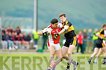 Dr Crokes Kieran O'Leary tackles Rathmore's Aidan O'Mahony during their County Championship clash in Rathmore Sunday evening