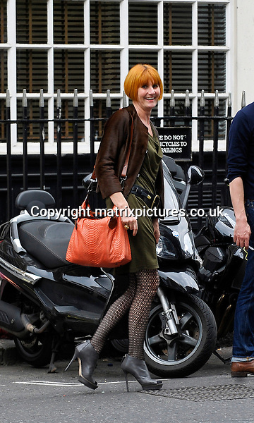 NON EXCLUSIVE PICTURE: MATRIXPICTURES.CO.UK<br /> PLEASE CREDIT ALL USES<br /> <br /> WORLD RIGHTS<br /> <br /> English retail expert Mary &quot;Queen of Shops&quot; Portas is spotted filming on location in London, then leaving on a motorbike.<br /> <br /> JUNE 19th 2013<br /> <br /> REF: PSE 134202
