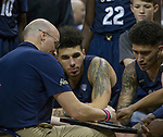 Akron head coach John Groce draws up a play during a timeout against Nevada in the second half of an NCAA college basketball game in Reno, Nev., Saturday, Dec. 22, 2018. (AP Photo/Tom R. Smedes)