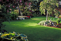 RESIDENTIAL GARDEN MANICURED LAWN AND ROCKERY. flower, control, order, hosta. VICTORIA BRITISH COLUMBIA CANADA 10 MILE POINT.