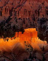 730750092cv a small shaft of sunset light brightens a row of hoodoos in the silent city in bryce canyon national park utah