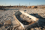 Derelict boat and ruins from the flooding and salt incursion of the Salton Sea, Salton Sea, Calif.