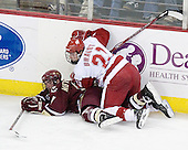 Brett Motherwell 8 of Boston College is able to control the puck despite Andy Brandt 21 of the University of Wisconsin. The Boston College Eagles defeated the University of Wisconsin Badgers 3-0 on Friday, October 27, 2006, at the Kohl Center in Madison, Wisconsin in their first meeting since the 2006 Frozen Four Final which Wisconsin won 2-1 to take the national championship.<br />