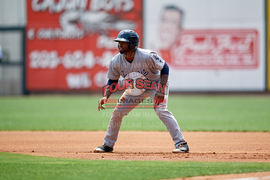 Pensacola Blue Wahoos center fielder Daniel Sweet (11) leads off first base during a game against the Birmingham Barons on May 9, 2018 at Regions Field in Birmingham, Alabama.  Birmingham defeated Pensacola 16-3.  (Mike Janes/Four Seam Images)