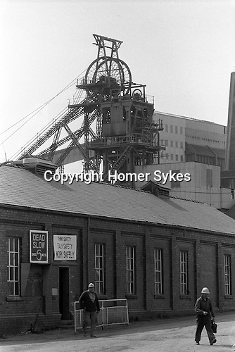 The Pit head. South Kirkby Colliery, Yorkshire England. Coal Miners story 1979. Opened in 1881, closed in 1988 and later demolished.  The building in the forefront is the lamproom of the colliery. It also housed the underground electricians meeting room, commonly known by it's colliery internal phone number of 118.<br />