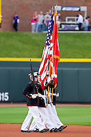 The American and North Carolina state flags are presented by the color guard prior to the Carolina League game between the Lynchburg Hillcats and the Winston-Salem Dash at BB&T Ballpark on May 7, 2011 in Winston-Salem, North Carolina.   Photo by Brian Westerholt / Four Seam Images