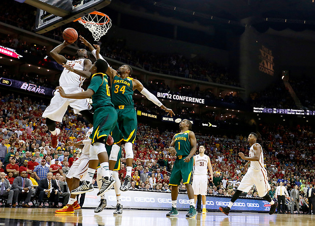 Iowa State's Dustin Hougue (22) scores around Baylor's Royce O'Neale and Cory Jefferson (34) during the Big 12 championship game Saturday, March 15, 2014 in Kansas City, Mo.