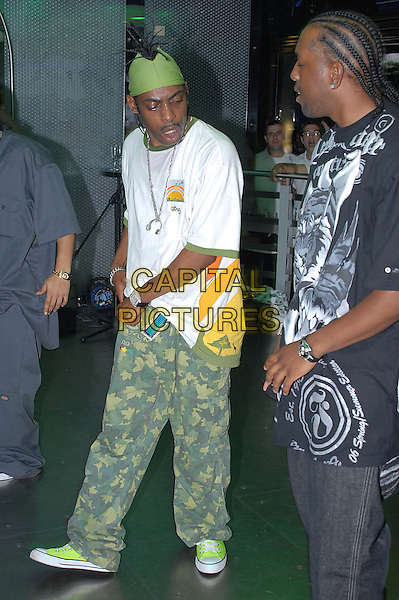COOLIO (Leon Ivey, Jr.).Performs live at Mayhem Nightclub, Southend, Essex, UK..June 29th, 2006.stage concert gig performance music t-shirt white full camouflage trousers length green bandana .CAP/BRC.©Ben Rector/Capital Pictures.