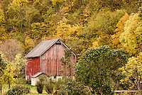 Red barn against autumn colored hillside in central Wisconsin.