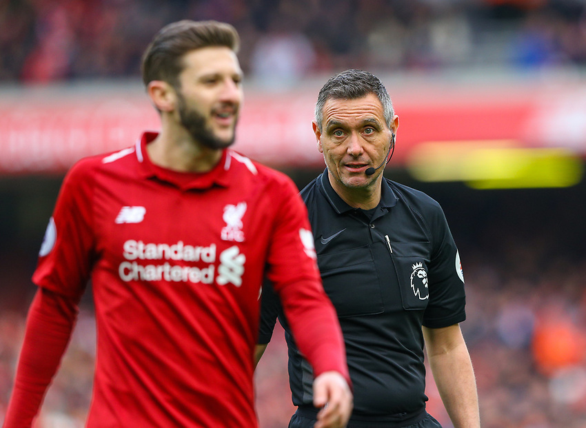 Referee Andre Marriner has a word with Liverpool's Adam Lallana<br /> <br /> Photographer Alex Dodd/CameraSport<br /> <br /> The Premier League - Liverpool v Burnley - Sunday 10th March 2019 - Anfield - Liverpool<br /> <br /> World Copyright © 2019 CameraSport. All rights reserved. 43 Linden Ave. Countesthorpe. Leicester. England. LE8 5PG - Tel: +44 (0) 116 277 4147 - admin@camerasport.com - www.camerasport.com