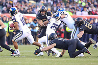 Philadelphia, PA - December 8, 2018:  Navy Midshipmen quarterback Malcolm Perry (10) avoids the tackle of Army Black Knights linebacker James Nachtigal (19) during the 119th game between Army vs Navy at Lincoln Financial Field in Philadelphia, PA. (Photo by Elliott Brown/Media Images International)