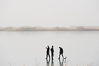 "Asien CHINA Provinz Xinjiang Han chinesische Touristen auf zugefrorenen Dawakun See in Taklamakan Wueste im Winter  | .Asia CHINA province Xinjiang , Han chinese Tourist  at frozen Dawakun lake in Taklamakan desert in winter season .| [ copyright (c) Joerg Boethling / agenda , Veroeffentlichung nur gegen Honorar und Belegexemplar an / publication only with royalties and copy to:  agenda PG   Rothestr. 66   Germany D-22765 Hamburg   ph. ++49 40 391 907 14   e-mail: boethling@agenda-fototext.de   www.agenda-fototext.de   Bank: Hamburger Sparkasse  BLZ 200 505 50  Kto. 1281 120 178   IBAN: DE96 2005 0550 1281 1201 78   BIC: ""HASPDEHH"" ,  WEITERE MOTIVE ZU DIESEM THEMA SIND VORHANDEN!! MORE PICTURES ON THIS SUBJECT AVAILABLE!! ] [#0,26,121#]"