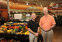 NWA Democrat-Gazette/ANDY SHUPE<br /> Kim Eskew (left), president and COO of Harps Food Stores Inc., and Roger Collins, CEO and chairman, stand Thursday, Sept. 10, 2015, in the Harps Food Stores location at 2894 W. Sunset Ave. in Springdale. Harps Food Stores is celebrating 85 years in business and is preparing to open its first location in Kansas next year.