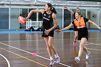 06.10.2013 Silver Fern Irene Van Dyk and Anna Thompson in action during the Silver Ferns training in Melbourne Australia. Mandatory Photo Credit ©Michael Bradley.