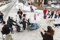 Martin Buser runs down Cordova Street giving high-fives to spectators during the Ceremonial Start of the 2016 Iditarod in Anchorage, Alaska.  March 05, 2016