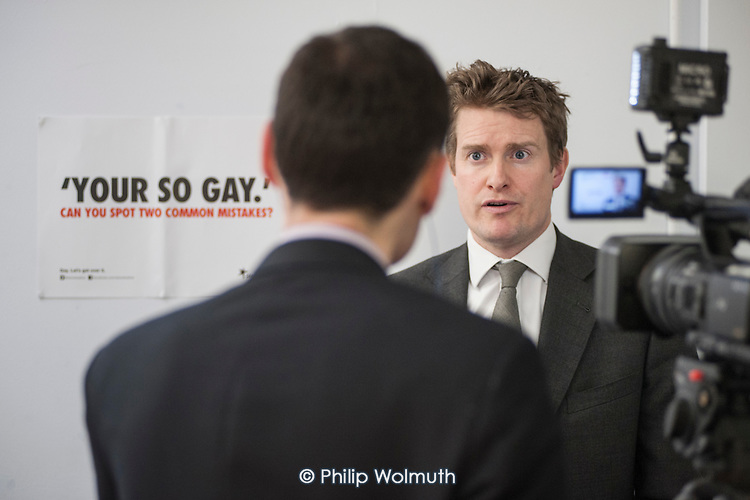 A Press Association journalist at work.  Labour Shadow Education Minister Tristram Hunt MP on a visit to Little Ilford School in Newham, London, to discuss the school's work with Stonewall on its campaign against homophobic bullying.