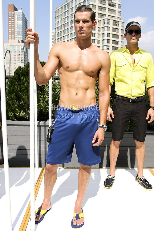 Dan Schwarz poses in a blue performance nylon spandex short from the Nautica Men's Spring 2013 collection by Chris Cox, during New York Fashion Week Spring 2013, September 7, 2012.