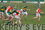 Kerry's Eoin Sheehy and Armagh's Paul McCormack.