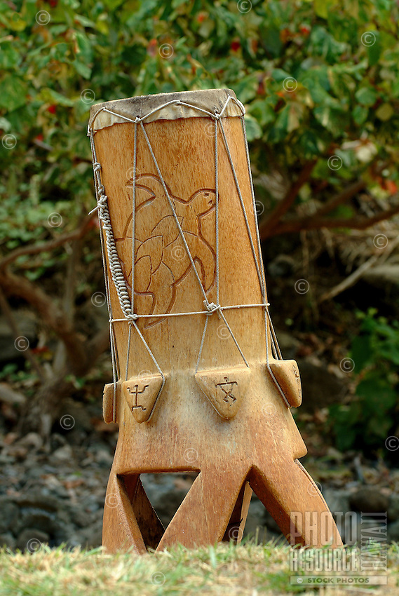 Handmade drum featuring carved turtle and petroglyph figures
