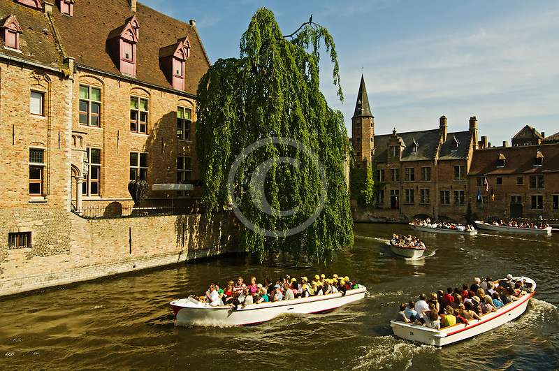 Belgium, Bruges, Tourist sightseeing boats on canal