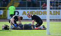Lincoln City's Harry Anderson receives treatment for an injury from Lincoln City's head of sports science and medicine Mike Hine, left, and Lincoln City assistant sports therapist Luke Treadwell<br /> <br /> Photographer Chris Vaughan/CameraSport<br /> <br /> The EFL Sky Bet League Two - Carlisle United v Lincoln City - Friday 19th April 2019 - Brunton Park - Carlisle<br /> <br /> World Copyright © 2019 CameraSport. All rights reserved. 43 Linden Ave. Countesthorpe. Leicester. England. LE8 5PG - Tel: +44 (0) 116 277 4147 - admin@camerasport.com - www.camerasport.com