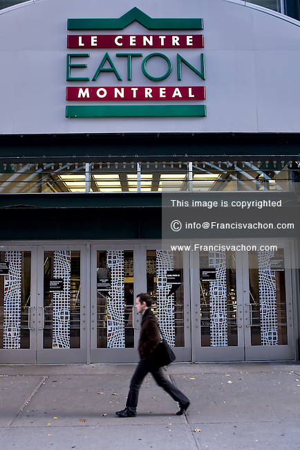 A man walks by the Centre Eaton Montreal in Montreal November 3, 2008. The Montreal Eaton Centre is the largest downtown shopping centre in the city, houses over 175 shops and restaurants, a foreign exchange office and an indoor parking lot.