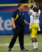 Michigan Head Coach Brady Hoke talks with Michigan cornerback J.T. Floyd during Sugar Bowl game against Virginia Tech at Mercedes-Benz SuperDome in New Orleans, Louisiana on January 3rd, 2012.  Michigan defeated Virginia Tech, 23-20 in first overtime.