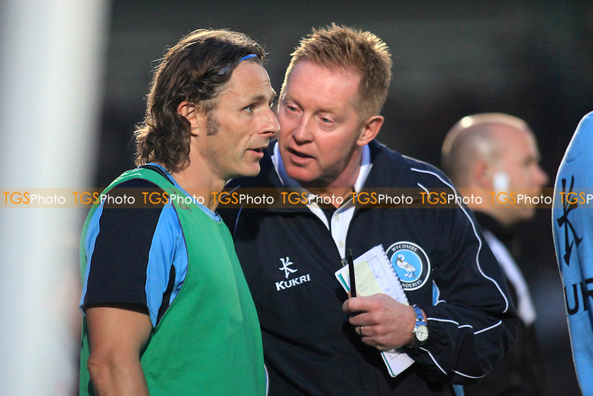 Wycombe Manager, Gary Waddock has a last bit of advice for his Player/Coach Gareth Ainsworth as he gets ready to take the field - Wycombe Wanderers vs Watford - Friendly Football Match at Adams Park, High Wycombe, Buckinghamshire - 31/07/12 - MANDATORY CREDIT: Paul Dennis/TGSPHOTO - Self billing applies where appropriate - 0845 094 6026 - contact@tgsphoto.co.uk - NO UNPAID USE.
