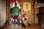 Family Portrait of Alfredo, Rouuena and the son Gian Alfredo, Narra, jan 2012..They own a farm land in Narra just in the bottom of the mining site, their land has been affected by the tossic waste of the Mine,7