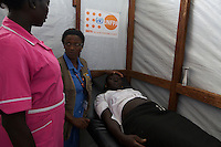 UNFPA South Sudan supports human capacity building in the health sector. UNV performing a patient check-up at the reproductive health clinic at POC1 in Juba where currently 15.000 IDPs live.