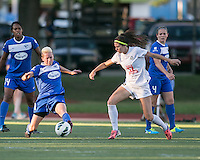 In a National Women's Soccer League Elite (NWSL) match, the Boston Breakers defeated the FC Kansas City, 1-0, at Dilboy Stadium on August 10, 2013.  Boston Breakers midfielder Joanna Lohman (11) intercepts the ball in front of FC Kansas City midfielder/forward Erika Tymrak (15).
