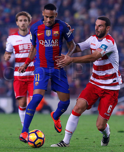 29.10.2016 Barcelona. La Liga football league.  Neymar is held back by the contact with Rodríguez Lombán during the league game between FC Barcelona against Granada CF at camp nou