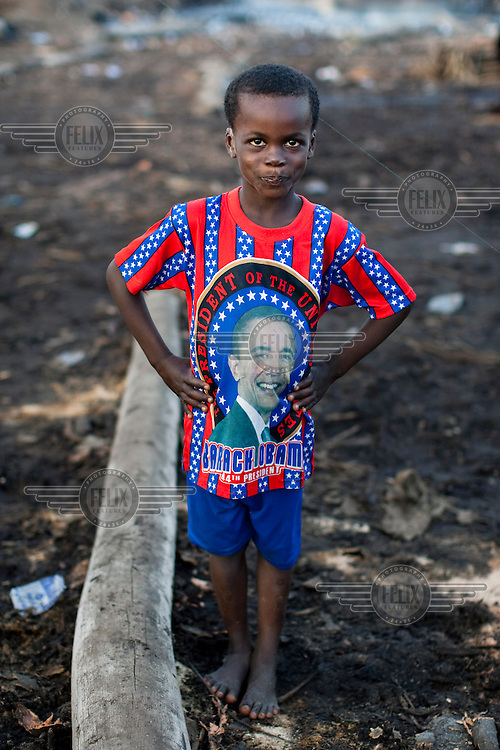 A child wears a Barack Obama t-shirt in the Ebute Metta neighbourhood, home to Lagos's timber milling industry.