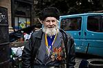 An old man, veteran of the World War II, is supporting the revolution in Kiev, Ukraine. He is proudly showing his chest full of medals.<br /> Anziano sostenitore della rivoluzione di Piazza Maidan, reduce dalla Seconda guerra mondiale, Kiev, Ukraina.
