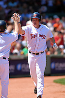 OF Jason Place of the Portland Sea Dogs, the AA E.L. affiliate of the Boston Red Sox, celebrates his first AA HR after clearing the green monster during the Futures at Fenway at Fenway Park in Boston, MA on August 8, 2009 (Photo by Ken Babbitt/Four Seam Images)